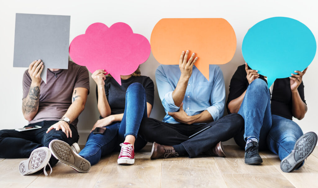 Group of diverse people with speech bubbles